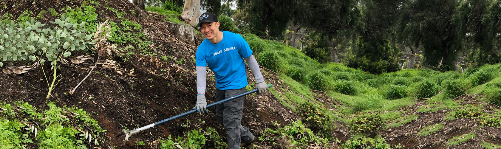 Volunteer helping at tree-planting event