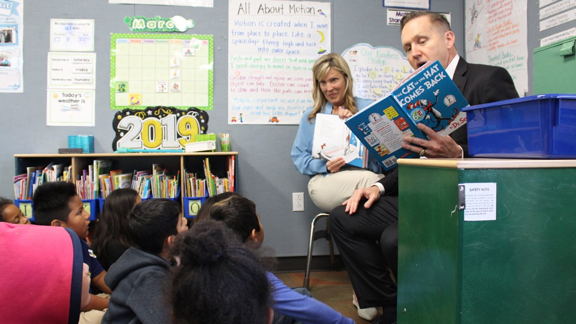 Jeffrey Martin reads to students during a recent visit to an elementary school.