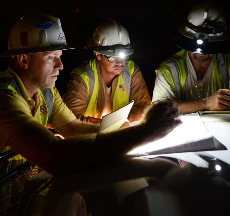 Oncor workers at  night
